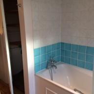 Before - bath and cupboard